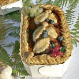 Chicken liver, blueberry and red currant terrine in a wooden mold