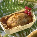 Four-meat terrine with red currants in a wooden baking mold