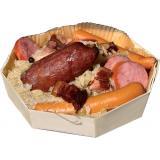 Morteau sausage sauerkraut in a wooden dish