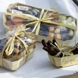 Candied orange peel and chocolates in a Tom Pouce wooden container