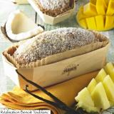 Tropical fruit and coconut brioche presented in a wooden container